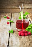 Drink of fresh raspberries. And ripe raspberry on the old wooden table. health and diet food Royalty Free Stock Photos