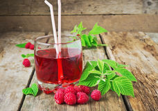 Drink of fresh raspberries. And ripe raspberry on the old wooden table. health and diet food Royalty Free Stock Photography