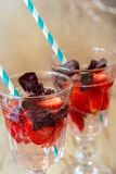 Drink with fresh strawberry and basil on glass Stock Photography