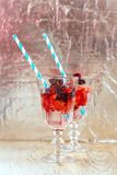 Drink with fresh strawberry and basil on glass Stock Images