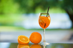 Drink and fruit. Alcoholic drink and fruit on a table with a blurred background Stock Photos