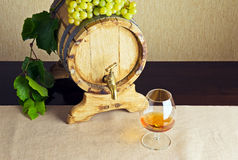 Glass of brandy on the table Royalty Free Stock Photography