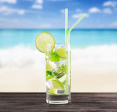 Glass of mojito cocktail on a beach Royalty Free Stock Image