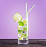 Glass of mojito cocktail on pastel pink background stock image