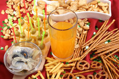 drink in a glass and snacks in the background Royalty Free Stock Photos