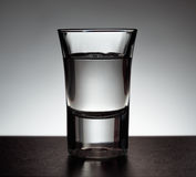 Glass of vodka on grey background Royalty Free Stock Photos