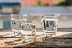 Drink a glass of water on a wooden floor. Drink a glass of water on a wooden floor Stock Image