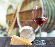 Glass of wine and cheese in winery Royalty Free Stock Image