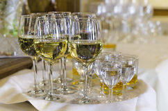 Drink glasses. Partially filled party drink glasses on a tray stock photo