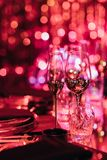 Drink glasses in blurred light for party Royalty Free Stock Image