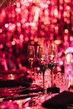 Drink glasses in blurred light for party Royalty Free Stock Photo