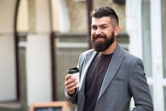 Drink it on the go. Man bearded hipster prefer coffee take away. Businessman drink coffee outdoors. Reloading energy. Relaxing coffee break. Hipster hold paper royalty free stock image