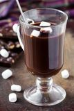 Drink hot chocolate with marshmallows in transparent glass Royalty Free Stock Image
