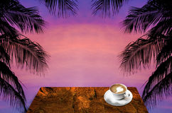 Drink hot coffee with coconut tree silhouette Stock Photos