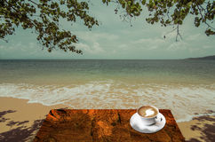 Drink hot coffee beside sea Stock Images