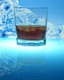 Drink with ice. On a blue background Stock Photo