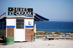Drinks and ice cream. A photograph of a kiosk selling ice cream and soft drinks at a deserted place with the sea as background Stock Photo