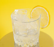 Drink with Ice and Lemon Slice Stock Images