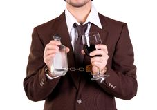Drink and jail. Man being irresponsible in drinking and put self to jail royalty free stock photo