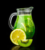 Drink with kiwi and lemon in a glass jug Stock Images