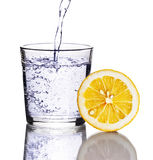 Drink with lemon. On white Royalty Free Stock Photo