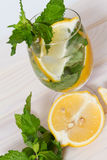 Drink with lemon and mint. Refreshing nonalcoholic drink with lemon and mint Stock Image