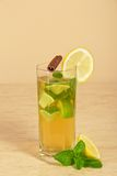 Drink with a lemon slice, stick of cinnamon and Stock Images