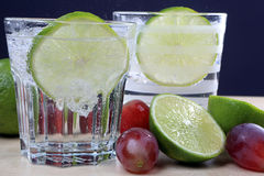 Drink with lime, grape and ice Stock Photography