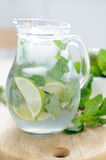 Drink with lime and mint. Cool summer drink with lime and mint Stock Photo