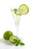 A drink with lime and mint in a champagne glass Royalty Free Stock Photos