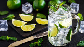 Drink with lime, mint and ice Stock Photos