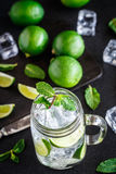 Drink with lime, mint and ice Royalty Free Stock Image