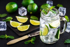 Drink with lime, mint and ice Royalty Free Stock Photos