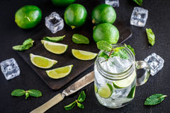 Drink with lime, mint and ice Royalty Free Stock Images