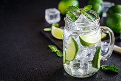 Drink with lime, mint and ice Stock Photo