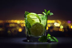 Drink with lime and peppermint leaves Royalty Free Stock Photos