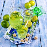 Drink of lime and tarragon. In a glass on a wooden background. Selective focus stock image