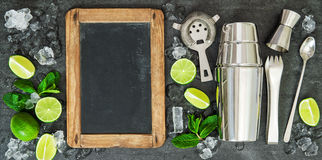 Drink making tools ingredients Lime mint blackboard Stock Image