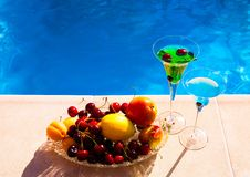 Drink. Margarita and absinthe, fruits and berries, blue backgrou Stock Photography