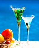 Drink. Margarita and absinthe, fruits and berries, blue backgrou Stock Image