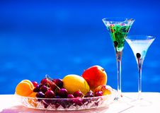 Drink. Margarita and absinthe, fruits and berries, blue backgrou Royalty Free Stock Image