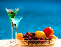 Drink. Margarita and absinthe, fruits and berries, blue backgrou Royalty Free Stock Images