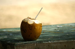 Drink me. A water coconut with a straw Royalty Free Stock Photo