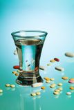 Drink and medicine pills Stock Photo