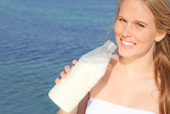 Drink milk. Healthy woman drinking bottle of milk drink Royalty Free Stock Photos