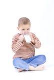 Drink milk. Cute, little boy driniking milk, on white Royalty Free Stock Photography