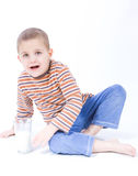 Drink milk. Cute, little boy driniking milk, on white Stock Photography