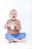 Drink milk. Cute, little boy driniking milk, on white Stock Photos