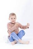 Drink milk. Cute, little boy driniking milk, on white Stock Images