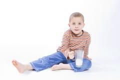 Drink milk. Cute, little boy driniking milk, on white Stock Photo